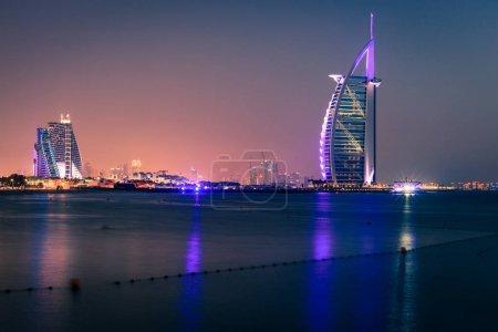 Dubai, UAE, June 7, 2016: view of Burj Al Arab and Jumeirah Beach hotels at night