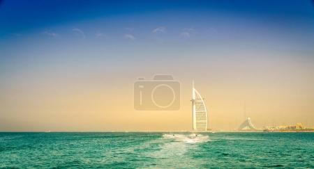 Jetskis near Dubai coast with Burj Al Arab and Jumeirah Beach hotels in the backdrop