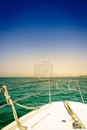 View of Dubai coast from the bow of a yacht