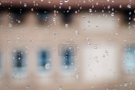 Close-up image of droplets of rain on the window glass
