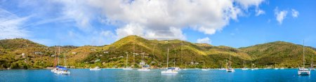 Panoramic view of harbor with anchored sailboats