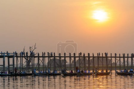 Sunset with silhouette of U bein bridge in Myanmar