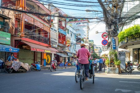 Photo for Ho Chi Minh City, Vietnam - January 1, 2017: street view of Pham Ngu Lao street, the backpacker district of Saigon. - Royalty Free Image