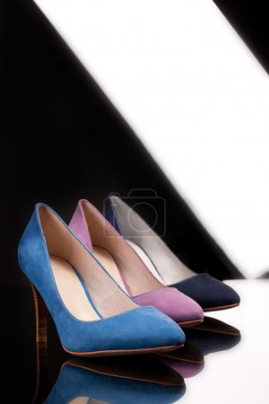 Woman's Shoes On A Glass Background