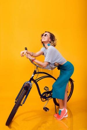 Young woman with retro bike