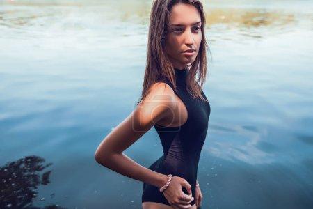 Beautiful woman in river