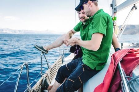 happy men fishing on the yacht