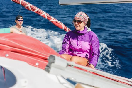 young woman yachting in sea