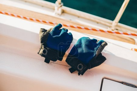 working gloves on the yacht