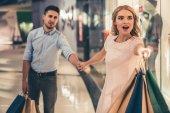 """Постер, картина, фотообои """"Couple doing shopping"""""""
