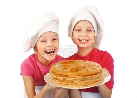 Happy little girls with pancakes