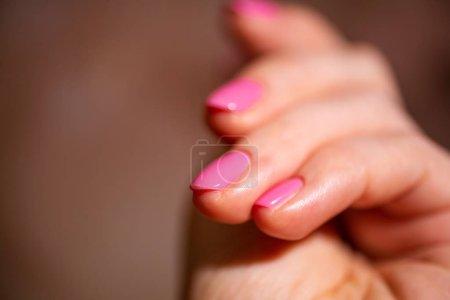 Photo pour Conception des clous. Hands With Pink Summer Manicure On Grey Background. Close Up Of Female Hands. Art Nail. - image libre de droit