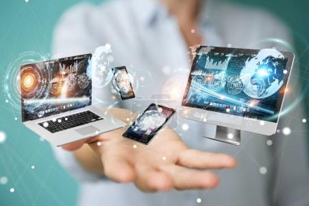 Photo for Tech devices connected to each other by businesswoman on blurred background 3D rendering - Royalty Free Image