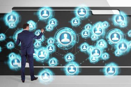 Businessman using social network interface on a board 3D renderi
