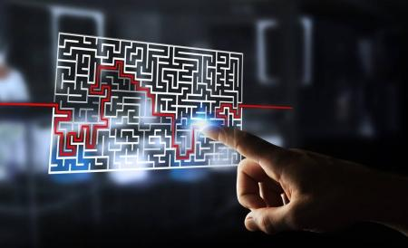 Photo for Businesswoman on blurred background searching solution of a complicated maze - Royalty Free Image