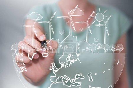 Businesswoman drawing renewable energy sketch