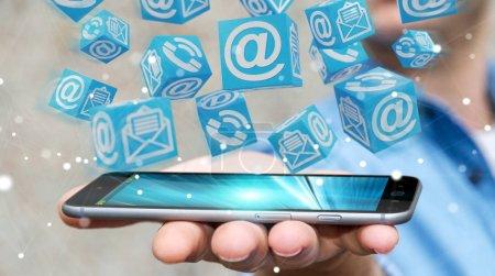 Photo pour Homme d'affaires sur fond flou en utilisant le contact cube flottant rendu 3D - image libre de droit
