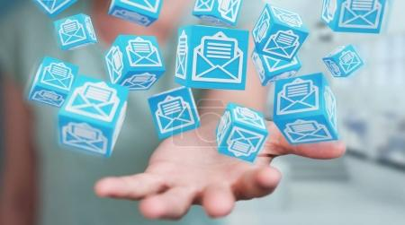 Businesswoman using floating cube emails 3D rendering