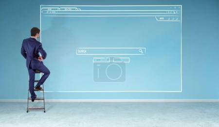Businessman watching website page sketch on a wall 3D rendering