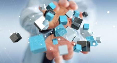 Geschäftsmann hält schwimmende blaue glänzende Würfel Netzwerk 3D-Renderin