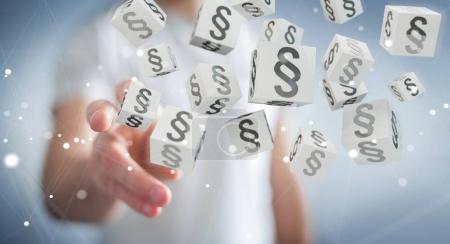 Photo pour Homme d'affaires sur fond flou en utilisant des cubes de loi de rendu 3D - image libre de droit