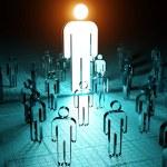 Leader illuminating a group of people on dark back...