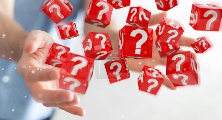 Businessman using cubes with 3D rendering question marks