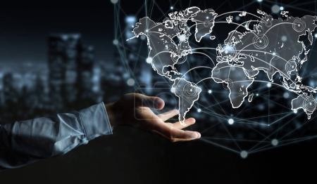 Photo pour Homme d'affaires sur fond flou tenant esquisse connexion mondiale - image libre de droit