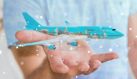 Photo pour Homme d'affaires sur fond flou avec avion et monuments célèbres du monde rendu 3D - image libre de droit