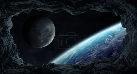 Photo for Dark asteroids flying close to planet Earth view from a cave 3D rendering elements of this image furnished by NASA - Royalty Free Image