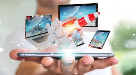 Photo for Businessman on blurred background connecting tech devices and startup rocket 3D rendering - Royalty Free Image