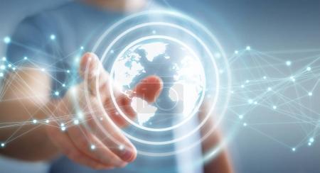 Homme d'affaires utilisant la planète Terre réseau sphère rendu 3D