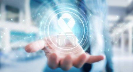 Photo pour Homme d'affaires sur fond flou à l'aide de cancer ruban numérique rendu 3d interface - image libre de droit