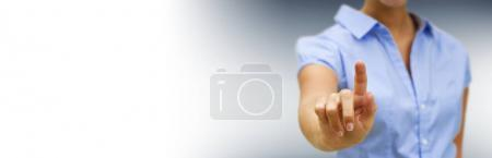 Panorama view of businesswoman pointing finger