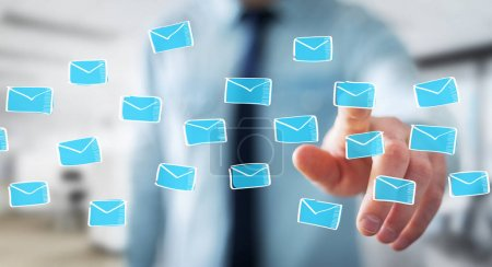 Businessman holding and touching floating emails sketch