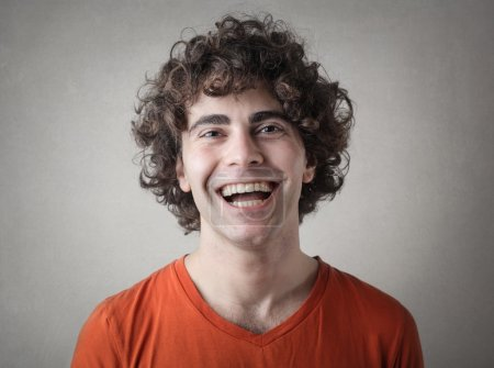 laughing curly haired man
