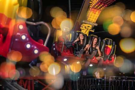 Photo for Friends in the amusement park have fun - Royalty Free Image