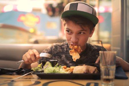 eating guy in arestaurant