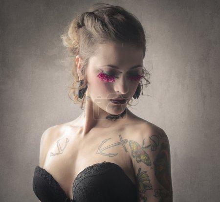 Tattooed  woman in lingerie