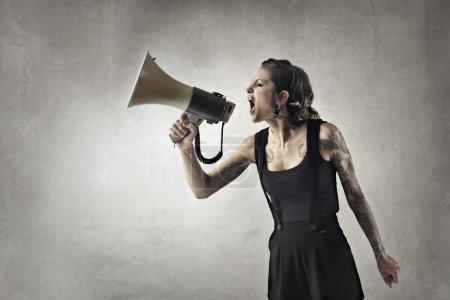 Girl shouting in a megaphone