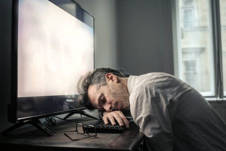 Businessman hbeing tired