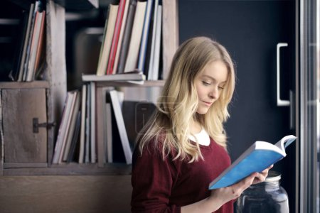 Blond woman with book