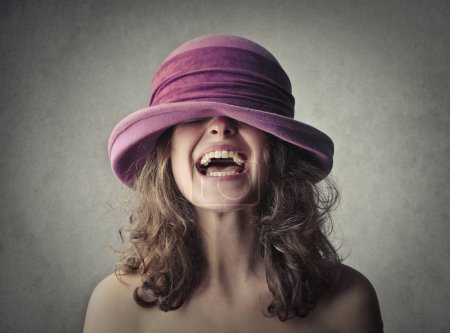 Laughing girl in hat