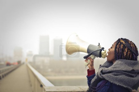 Photo for Black woman scream in a  megaphone - Royalty Free Image