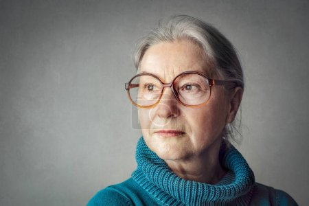 Old lady in glasses being serious