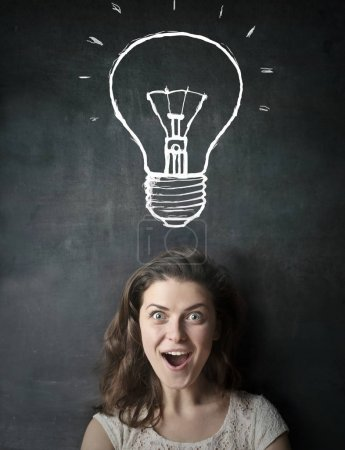 Brunette woman with a lightbulb over her head