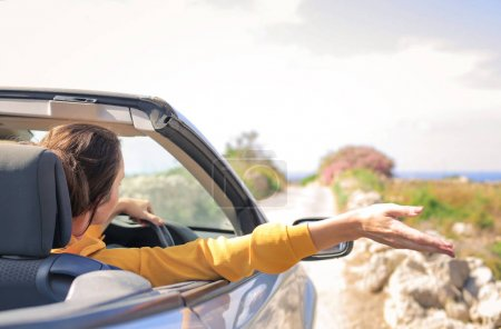 Photo for Woman driving car in the nature - Royalty Free Image