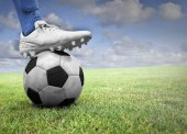 Soccer player stepping on the ball