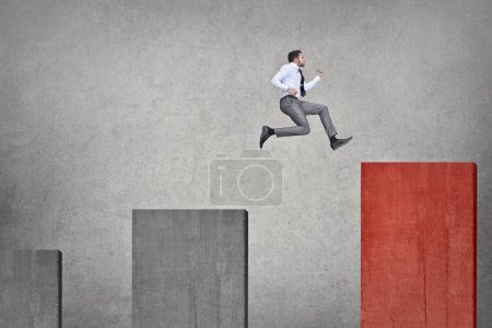 Businessman jumping on statistic