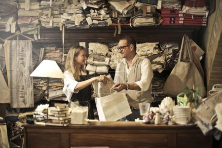 Two artisans with a shopping bag
